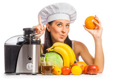Woman cook is pressing the juice from the fruit Royalty Free Stock Photos