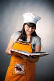 Woman cook reading recipes Stock Images