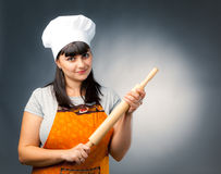 Woman cook with rolling pin Stock Photos