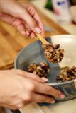Woman cook's hands preparing mushrooms in a ceramic bowl Royalty Free Stock Photos