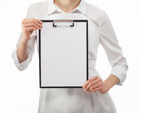 Woman cook's hands showing blank clipboard Royalty Free Stock Photography