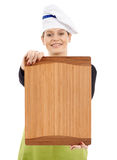 Woman cook showing a wooden board Royalty Free Stock Photos