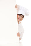 Woman cook smiling holding blank white paper Royalty Free Stock Image