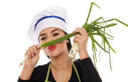 Woman cook with spring onions Stock Photos