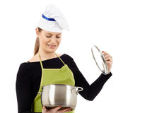 Woman cook with stainless pot Royalty Free Stock Images
