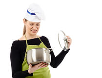 Woman cook with stainless pot Royalty Free Stock Photos