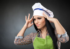Woman cook with strong migraine Royalty Free Stock Images