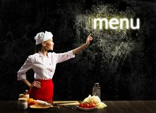 Woman cook touch glowing word menu. Concept collage stock image
