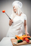 Woman cook with vegetables Stock Photo