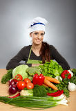 Woman cook with vegetables Stock Photography