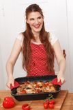 Woman with cooked dish Stock Photo