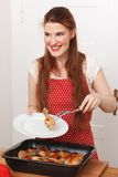 Woman with cooked dish Royalty Free Stock Photos