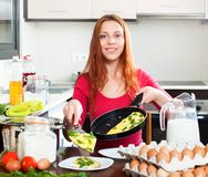 Woman  with cooked omelet Stock Image