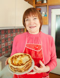 Woman with cooked pancakes Royalty Free Stock Photo