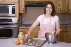 Woman cookie. A woman placing cookie dough on a baking sheet Royalty Free Stock Image