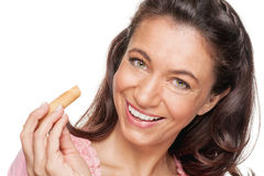Woman with cookie Royalty Free Stock Photos