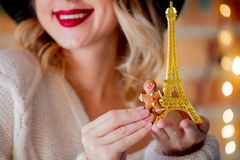 Woman with cookie and Eiffel tower royalty free stock photos
