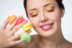 Woman with cookies makarons Royalty Free Stock Images