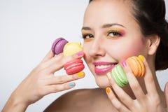 Woman with cookies makarons Stock Photos