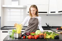 Woman cooking Stock Photos