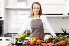 Woman cooking. In modern kitchen Royalty Free Stock Image