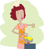 Woman cooking Royalty Free Stock Photos