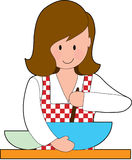 Woman Cooking. A woman stirring a recipe in a big bowl Royalty Free Stock Image
