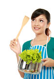 Woman cooking. Young woman thinking about something to cook Royalty Free Stock Photo