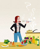 Woman Cooking. An attractive and elegant woman tasting a soup that she is cooking in their home Kitchen surrounded by healthy cooking ingredients Royalty Free Stock Photos