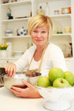 Woman cooking. And baking in the kitchen Stock Photography