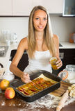Woman cooking apple pie Royalty Free Stock Images