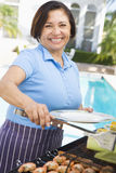Woman Cooking On A Barbeque Royalty Free Stock Images