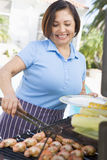 Woman Cooking On A Barbeque Stock Photography