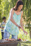 Woman Cooking Barbeque In Countryside Stock Photography