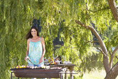 Woman Cooking Barbeque In Countryside Stock Images