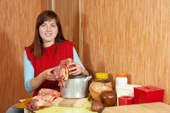 Woman  cooking  beef Royalty Free Stock Image