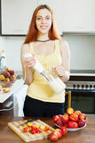 Woman cooking  beverages with nectarines Royalty Free Stock Photo
