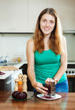 Woman cooking  boiled beets with grater Royalty Free Stock Photography
