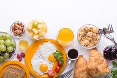 Woman cooking breakfast. Healthy breakfast ingredients, food frame. Granola, egg, dates,nuts, fruits, jam, berries, coffee, juice stock images
