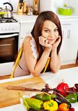 Woman cooking breakfast at kitchen. Royalty Free Stock Photo