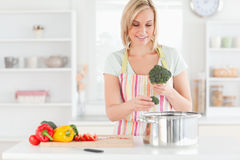 Woman cooking broccoli Stock Photo