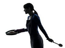 Woman cooking cake pastry silhouette Royalty Free Stock Photo