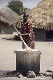 Woman cooking cassava, Bor Sudan Stock Images