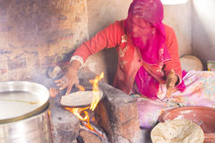 Woman cooking chapati Stock Images