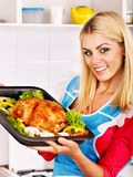 Woman Cooking Chicken At Kitchen. Stock Photos
