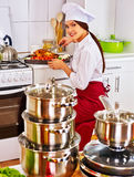 Woman cooking chicken at kitchen Royalty Free Stock Photo
