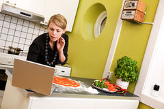 Woman Cooking with Computer Stock Photo