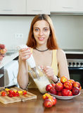 Woman cooking dairy beverages with  blender Royalty Free Stock Photography