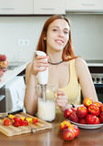 Woman cooking dairy beverages Royalty Free Stock Photos