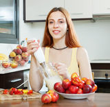 Woman cooking dairy beverages with  nectarines at  kitchen Stock Photos